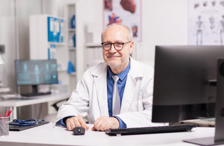 Positive elderly aged doctor